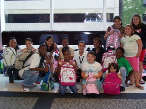 Melich-Munyan, surrounded by the children she worked with at the CDC.