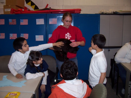 2008-09 Schweitzer Fellow Amy Vlazny talks with young students about responsible pet care.